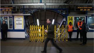 Man walking past closed platform