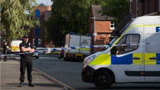 Полицейская машина и оцепление
