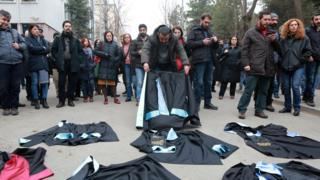 Academics lay down their gowns during a protest outside a university campus in Ankara (10 February 2017)
