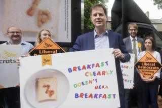 Nick Clegg unveils a campaign poster