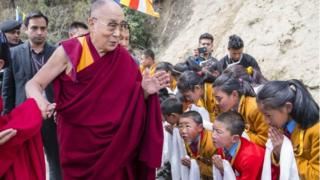 A handout photo made available by Tenzin Choejor, the Dalai Lama's Office shows followers greet Tibetan spiritual leader,