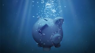 Piggy bank sinking in water