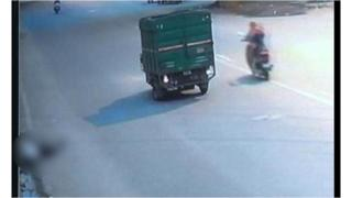 CCTV footage shows the man lying fatally injured at the side of the road after being hit by a van