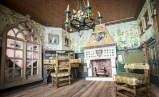 Eight-year-old Freya Gibson looks at a doll's house created by miniaturist Jane Fiddick, at Newby Hall, Yorkshire.