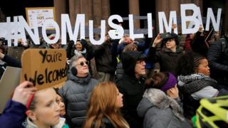 """Demonstrators spell out """"# No Muslim Ban"""" during the """"Boston Protest Against Muslim Ban and Anti-Immigration Orders"""""""