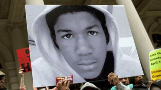 A protester holds up a photo of Trayvon Martin in New York City.