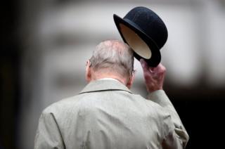 Prince Philip raises his hat