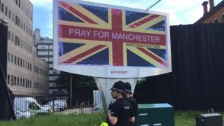 Billboard reading pray for Manchester