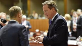 David Cameron talks to European Council President Donald Tusk during the EU summit in Brussels, Belgium on 15 Oct 2015