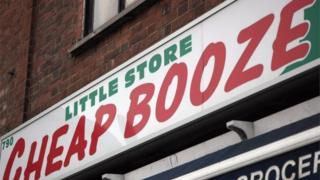 Cheap Booze sign over shop