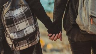 Gay school pupils hold hands
