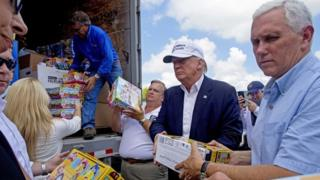 Republican presidential candidate Donald Trump and running mate, Indiana Gov. Mike Pence, unload donations for Louisiana flood victims.