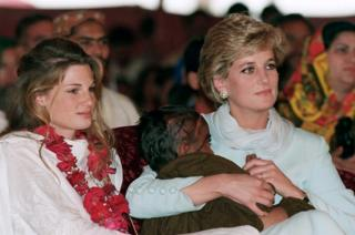 Diana, Princess of Wales wears a traditional shalwar khameez as she sits with Jemima Khan during a visit to Imran Khan's cancer hospital in Lahore, Pakistan in April 1996