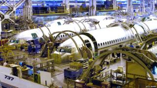 Three Boeing 737-800 fuselages sit in production at the Boeing Wichita plant