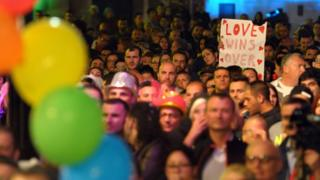 People gather to celebrate in Saint George's Square after the Maltese parliament approved a civil unions bill in Valletta