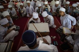 Malaysian religious students read the Koran at school during the Muslim holy fasting month of Ramadan in Hulu Langat, near Kuala Lumpur on 30 June 2014.