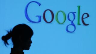 Google logo with silhouette of woman