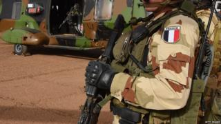 A French soldier of the detachment of the Operation Barkhane stands guard on January 2, 2015 at a French base outside the northern Malian city of Gao