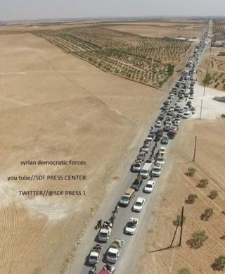 Photo released by the Syrian Democratic Forces (SDF) that it says shows Islamic State militants using human shields to flee the Syrian of Manbij in a convoy (12 August 2016)