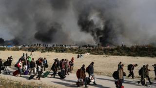 Fire breaks out in the Jungle camp as migrants prepare to leave while the authorities start to demolish the site on 26 October 2016 in Calais, France