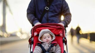 Dad with child in pram