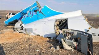 Debris from crashed Russian jet lies strewn across the sand at the site of the crash, Sinai, Egypt, 31 October 2015