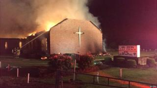 Fire crews try to control a blaze at the Mt Zion AME Church in Greeleyville, South Carolina - 30 July 2015