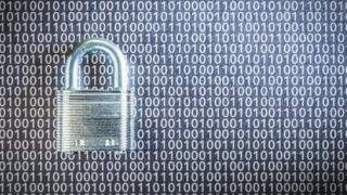 A padlock in front of digital data