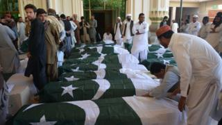 Mourners gather around coffins of victims of Quetta police academy attack