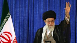 Iran's Supreme Leader Ayatollah Ali Khamenei waves to a crowd during a ceremony to mark the 27th anniversary of the death of Ayatollah Ruhollah Khomeini