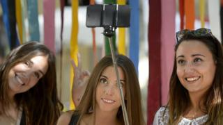Girls take a selfie in Spain