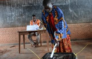 A woman casts her vote at a polling station in Ciri, northern Burundi, on May 17, 2018 during a referendum on constitutional reforms that, if passed, will shore up the power of incumbent President and enable him to rule until 2034.