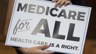 "A ""Medicare for all"" sign."