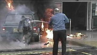 Off-duty police officer Stewart Ferguson hosed down the burning Kafeel Ahmed