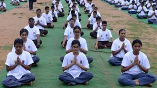 Groups participate in a mass yoga session to mark International Yoga Day at the parade grounds in Secunderabad, the twin city of Hyderabad on June 21, 2015.