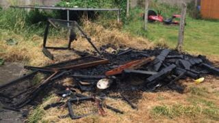 Remains of guinea pig hutch after arson attack