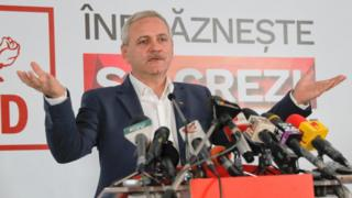 The head of the Social Democrat Party, Liviu Dragnea, speaks to media after exit polls were announced in the parliamentary elections in Bucharest, Romania,