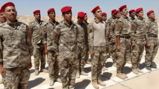Iraqi Sunni tribesmen attend a weapons-presentation ceremony at Camp Habbaniyah, near Ramadi, on 3 September 2015