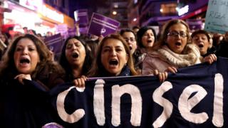 "Turkish female protesters shout slogans against the government as they hold placards reading ""Rape cannot be legalized"""