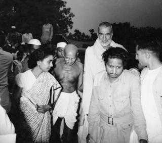 Gandhi with Khan Abdul Ghafar Khan and Sushila Nayar, his personal physician, arrive for a meeting.