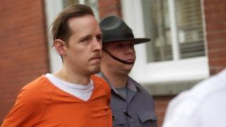 Eric Frein exits the Pike County Courthouse with police officers after an arraignment in Milford, Pennsylvania (31 October 2014)
