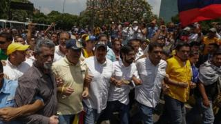 Several opposition deputies from Venezuelan National Assembly lead a protest in Caracas, Venezuela, on 10 April 2017.