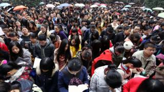 Applicants get ready for China's National Civil Service Exam, which attracts a million candidates each year