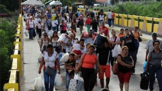 Venezuelans at the bridge from Cucuta in Colombia returning to San Antonio de Tachira in Venezuela, on July 10, 2016.