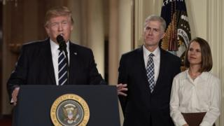 Judge Neil Gorsuch (c) and his wife Marie Louise look on, after US President Donald Trump nominated him
