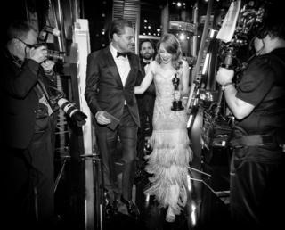 Leonardo DiCaprio and Emma Stone backstage.