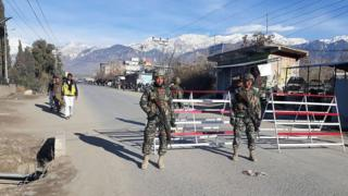 Pakistani soldiers stand guard at a checkpoint in Parachinar, capital of the Kurram tribal district, on 22 January 2017