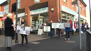 Protestors outside the Capricorn Animal Rescue shop in Mold