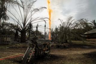 Burning oil well in Aceh
