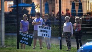 Local residents hold signs of support to welcome home Otto Warmbier at Lunken Airport in Cincinnati, Ohio, US, June 13, 2017.